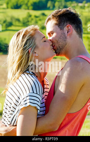 young,happy couple kissing - Stock Photo