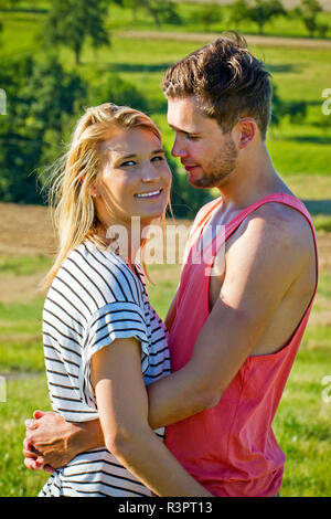 young,happy couple outdoors in nature - Stock Photo