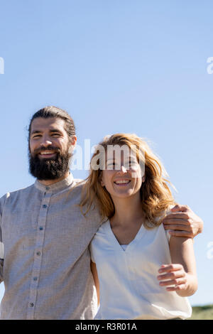 Portrait of a happy couple, spending time in nature - Stock Photo