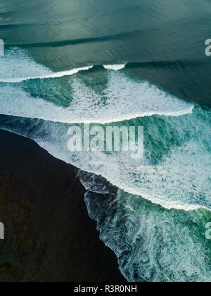 Indonesia, Bali, Aerial view of Uluwatu beach, breaking waves - Stock Photo