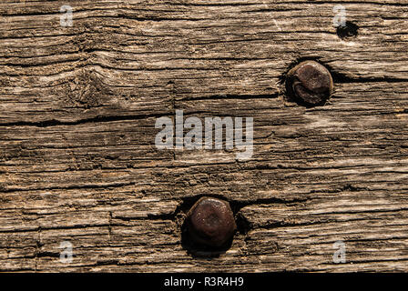 Old wooden bench texture with metal nut and bolt, closeup. Aged Solid Wood Shabby Background. - Stock Photo