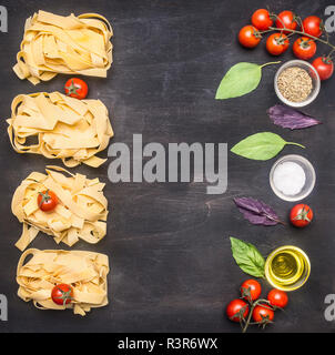 Healthy foods, cooking and vegetarian concept Raw Italian pasta with cherry tomatoes, mushrooms and butter, laid out on a rustic wooden background  bo - Stock Photo