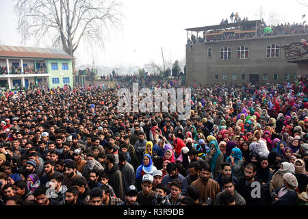 People watch the funeral of Azad Ahmad Malik alias Dada in Arwani Area of Kulgam district, Indian Administered Kashmir, some 70 kilometers away from Srinagar on 23 November 2018 Malik was killed in Shalgund village of Dashnipora in Bijbehara area of south Kashmir's Anantnag district on Friday. The slain Rebels have been identified as Azad Ahmad Malik alias Dada of Arwani, Basit Mir of Khanabal, Unais/ Anees of Takyibal, Bijbehara, Aqib of Waghama Bijbehara, Shahid from Awantipora and Firdaus Ahmad of Machpona Pulwama. (Photo by Muzamil Mattoo/Pacific Press) - Stock Photo