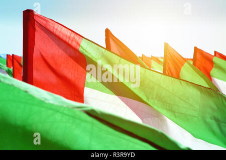 Close up fragment of waving flags of United Arab Emirates fluttering in the wind. United Arab Emirates independence day concept - Stock Photo