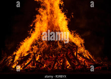 Blazing log fire, close-up - Stock Photo