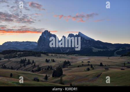 Italy, South Tyrol, Seiser Alm, Langkofel and Plattkofel at sunrise - Stock Photo