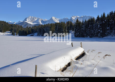 Germany, Werdenfelser Land, Kruen,  view to Karwendel mountains and frozen snow-covered Lake Geroldsee - Stock Photo