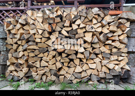 Dry chopped firewood logs ready for winter, Firewood wall background texture - Stock Photo