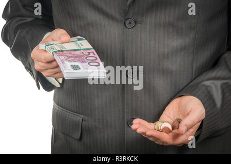 Businessman holds in one hand a bundle of euro money, and in the other a handful of coins, close-up, isolated on a white background - Stock Photo