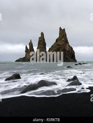 Basalt rock formations Troll toes on black beach. Reynisdrangar, Vik, Iceland - Stock Photo
