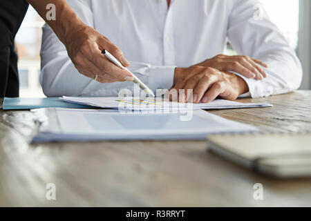 Businessman and woman discussing project - Stock Photo