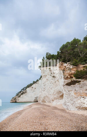 Italy, Vieste, empty Vignanotica Beach on a rainy winter day - Stock Photo