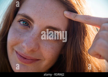 Portrait of smiling young woman with freckles Stock Photo