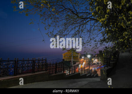 Shimla by night. View from the linking road between the Ridge and the Mall Road. Simla, Himachal Pradesh, India - Stock Photo