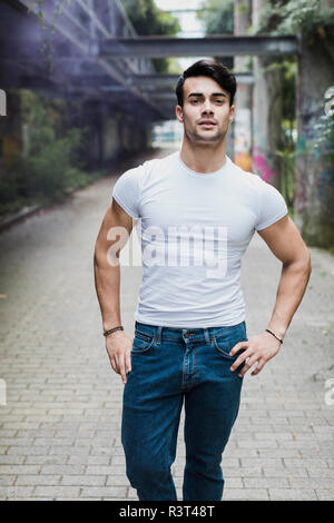 Portrait of handsome young man outdoors - Stock Photo