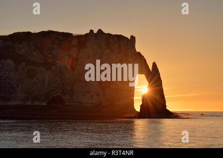France, Normandy, Cote d'Albatre, rock coast of Etretat by sunset - Stock Photo
