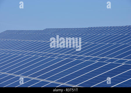 Germany, View of large number of solar panels at solar plant field