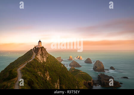 New Zealand, South Island, Otago,  Nugget Point Lighthouse at sunset - Stock Photo