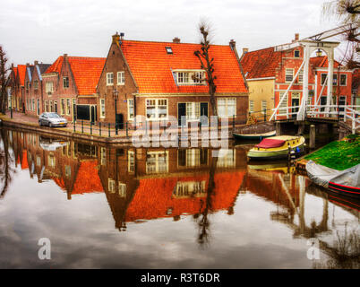 Netherlands, Monnickendam, Homes and Canal - Stock Photo