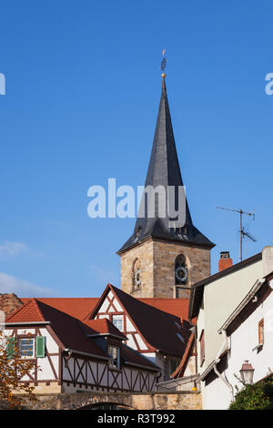 Germany, Rhineland-Palatinate, Freinsheim, typical half-timbered houses in wine village center and church - Stock Photo