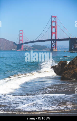 Classic panoramic view of famous Golden Gate Bridge seen from Baker Beach in beautiful summer sunny day with blue sky, San Francisco, California, USA - Stock Photo