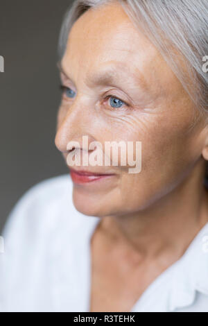 Half profile of blue eyed senior woman - Stock Photo
