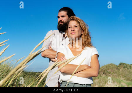 Confident couple spending time in nature - Stock Photo