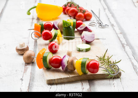 Vegetarian grill spits, orange and yellow paprika, tomato, red onion, zucchini and champignons