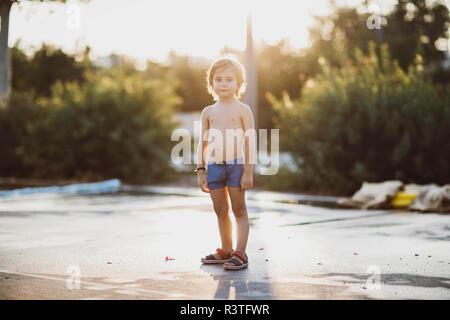 Portrait of a little boy , wearing trunks - Stock Photo