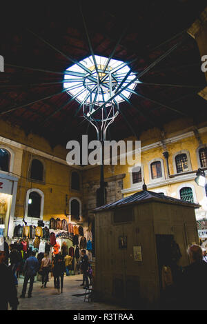 Istanbul, Turkey - April 5, 2012: Interior of the Grand Bazaar in Istanbul, full of vendors working. - Stock Photo