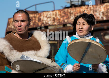 Russia, Komsomolskaya Bay, Chukotka Autonomous Okrug. Port of Provideniya. Native cultural show, locals in traditional attire, drumming. - Stock Photo