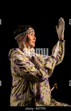 Russia, Komsomolskaya Bay, Chukotka Autonomous Okrug. Port of Provideniya. Native cultural show, woman in traditional attire. - Stock Photo
