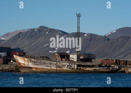 Russia, Komsomolskaya Bay, Chukotka Autonomous Okrug. Port of Provideniya, across the Bering Strait from Alaska. Fishing boats in port. - Stock Photo