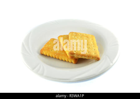 Biscuits cracker isolated / sheet of snack cracker biscuits on plate isolated on white background - Stock Photo
