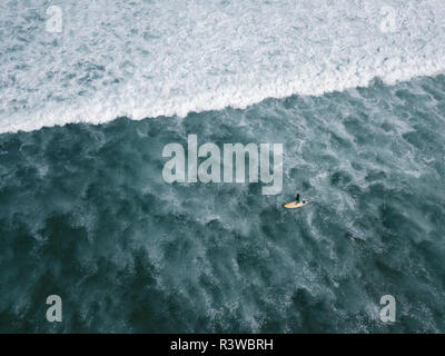 Indonesia, Bali, Aerial view of Balngan beach, surfer