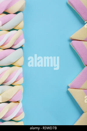 Beautiful colorful and delicious candy sweets and jelly marshmallows. Different shapes and composition on whitw background in foreground blurred with  - Stock Photo