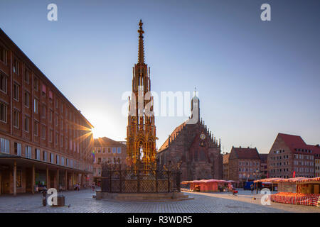 Schoner Brunnen fountain and Frauenkirche at sunrise, Nuremberg, Bavaria, Germany - Stock Photo