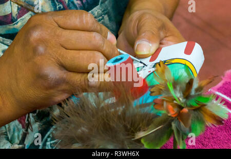 USA, Arizona, Phoenix. Close-up of Native American artist painting Kachina doll. Credit as: Wendy Kaveney / Jaynes Gallery / DanitaDelimont.com - Stock Photo