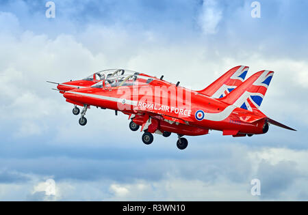 Two of the RAF Red Arrows display team take off in close formation. - Stock Photo