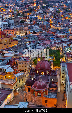 Guanajuato in Central Mexico. City overview in evening light with colorful buildings - Stock Photo