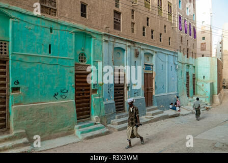 A man in traditional clothes walks in a street on May 8, 2007 in Shibam, Yemen. The old town of Shibam is a UNESCO World Heritage City. - Stock Photo