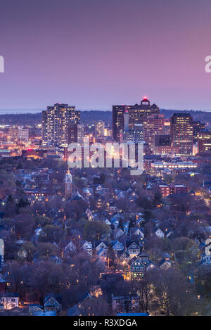 USA, Connecticut, New Haven, city skyline from East Rock Park at dusk - Stock Photo