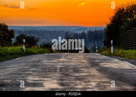 country road with evening sky - Stock Photo