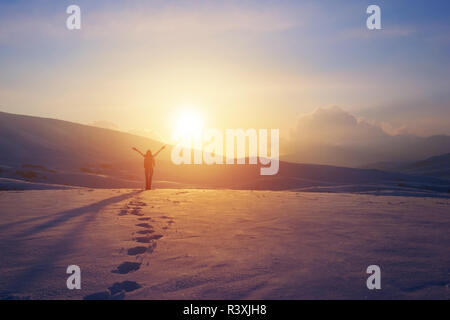 Happy woman in the mountains - Stock Photo