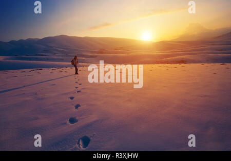 Traveler woman in the mountains - Stock Photo