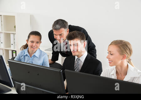 Businesspeople Working On Computers - Stock Photo