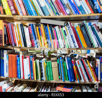 secondhand books in charity shop - Stock Photo