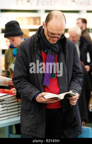 Hay Festival Winter Weekend, Hay on Wye, Wales, UK - Saturday 24th November 2018 - Male visitor browses the new books in the Festival bookshop - this years Hay Festival Winter Weekend features over 40 events and sessions - Photo Steven May / Alamy Live News - Stock Photo