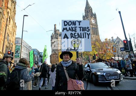 Manchester, UK. 24th Nov 2018. Extinction rebellion, climate protesters marching past the Town Hall, Manchester, UK, 24th November 2018 Credit: Barbara Cook/Alamy Live News - Stock Photo