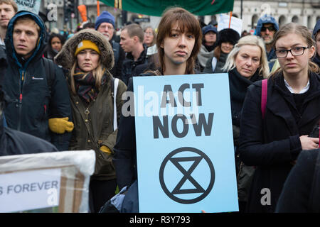 London UK 24th November 2018  Protesters carry signs during a climate change protest. Credit: Thabo Jaiyesimi/Alamy Live News - Stock Photo